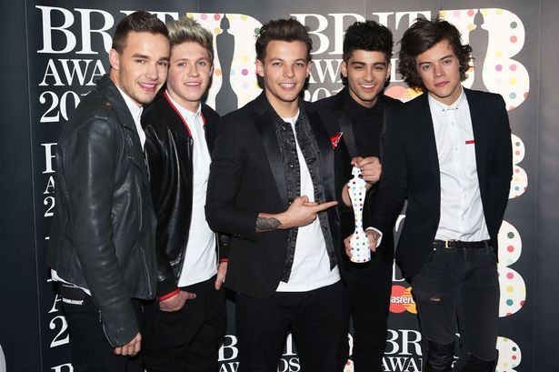 Liam-Payne-Niall-Horan-Louis-Tomlinson-Zayn-Malik-and-Harry-Styles-of-One-Direction-pose-with-their-Brits-Global-2266531